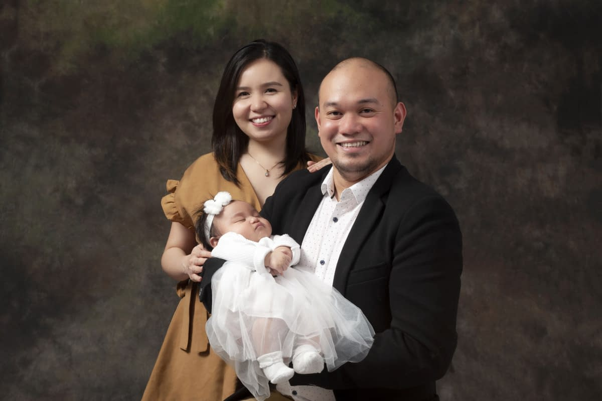 Photographer for Family photos. Mother and Father with newborn baby taken at moments in time photography studio Halifax